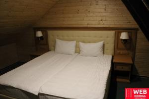 Верхняя комната Семейного номера отеля Косино